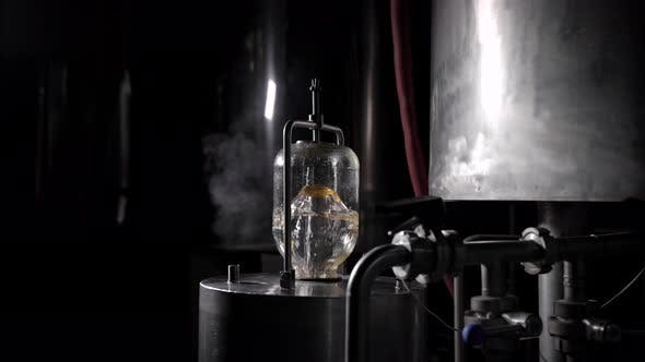 Thumbnail for Water Preparation on Beer Factory, Water Is Boiling and Filtering in Glass Vial on Metal Vat