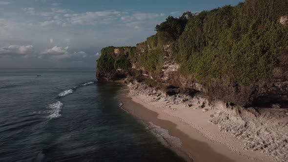 Thumbnail for Aerial View From a Sandy Beach at the Sunset with an Amazing Cliff Range