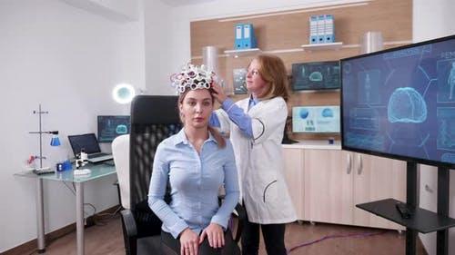 Female Scientist in a Neuroscience Facilty with a Patient