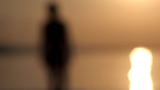 Thumbnail for Silhouette Of Girl Walking On The Water