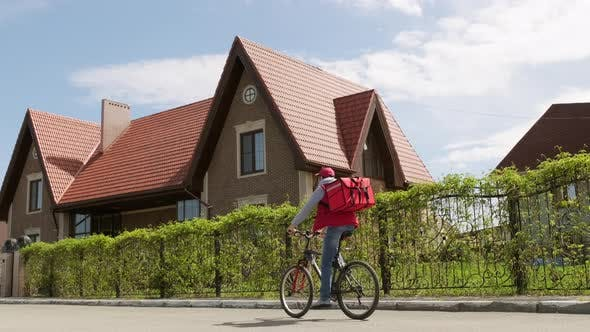 Thumbnail for Delivery Man with Insulated Backpack Riding Bicycle