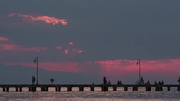 Thumbnail for Timelapse of People on Pier in the Evening
