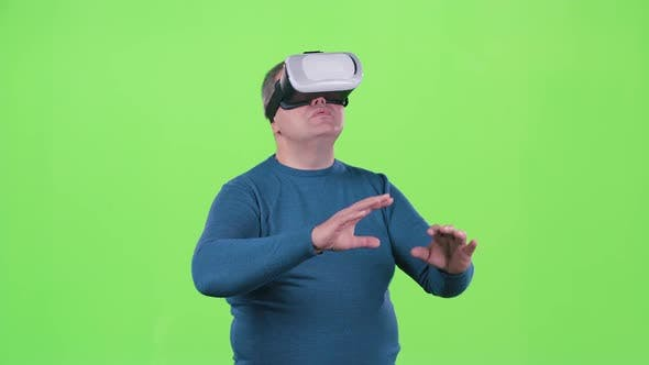 Thumbnail for Man Is Looking at 3d Glasses. Green Screen