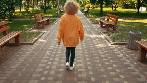 Thumbnail for Blonde Female Walks in City Park