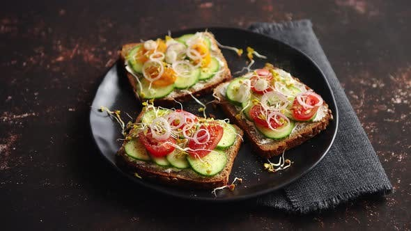 Thumbnail for Healthy Toasts with Cucomber, Tomatoes and Crumbled Feta and Radish Sprouts