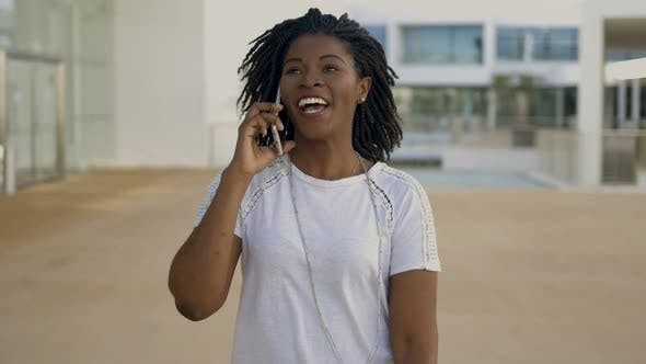 Thumbnail for Front View of Happy Woman with Dreadlocks Talking on Phone