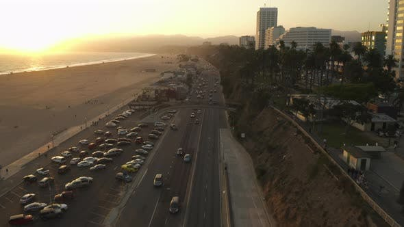 Thumbnail for AERIAL: View of Pacific Coast Highway PCH Next To Santa Monica Pier, Los Angeles with Light Traffic