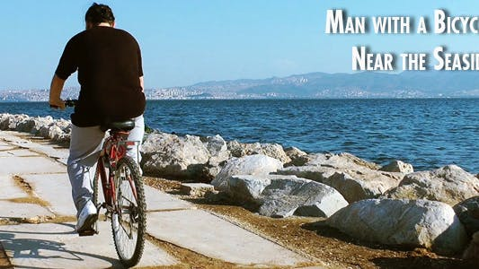 Thumbnail for Man With A Bicycle Near The Seaside