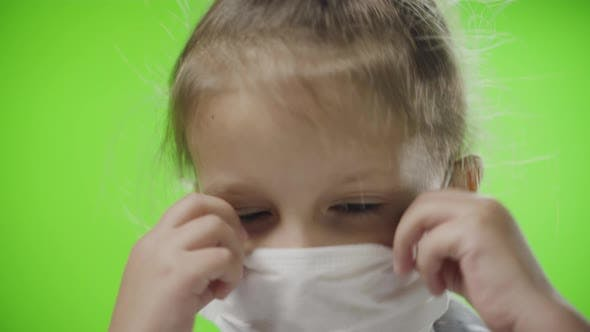Thumbnail for Little Girl Child On Green Screen Chroma In Medical Mask On Face