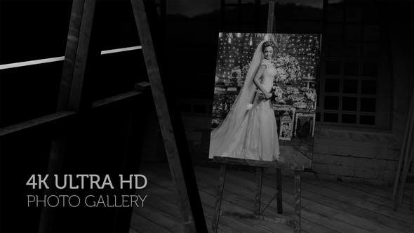 Galería de fotos en blanco y negro en un estudio de arte por la noche