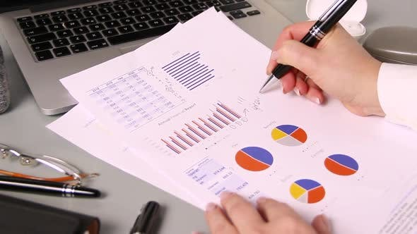 Business woman hands writing GROWING on report close up