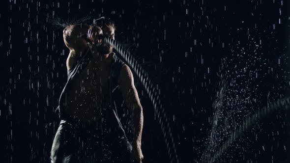 Thumbnail for Athletic Man Working Out In The Rain
