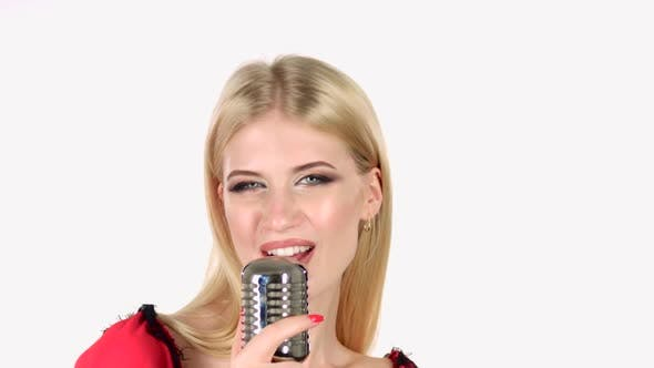 Thumbnail for Girl Dances and Sings in a Retro Microphone. White Background. Close Up