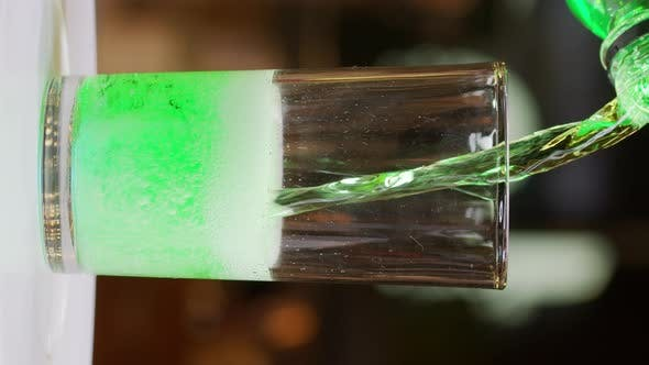 Pouring Green Soft Drink Into a Glass , Close-up Slow Motion Shot Pocket 6K.