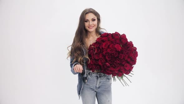 Thumbnail for Attractive Woman Going To Camera with Bouquet of Red Roses