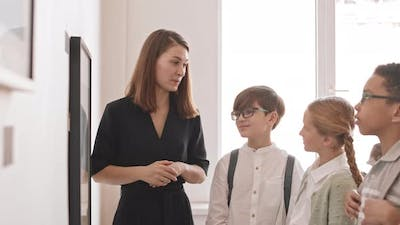 Woman Presenting Painting to Children in Gallery