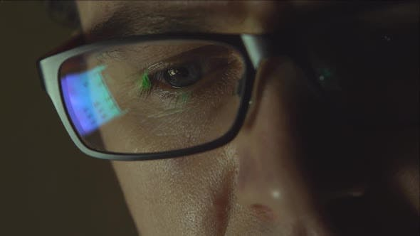 The reflection at the glasses of young man: looking a site