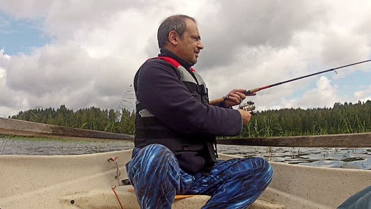 Thumbnail for Fisherman Catches A Fish On Rowing Boat