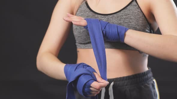 Thumbnail for Handsome Caucasian Blonde Woman Wrapping Her Hands with Wraps for Boxing