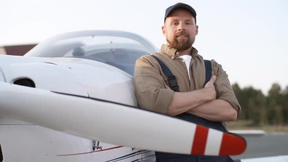 Thumbnail for Portrait of Mechanic Standing Next to Aircraft