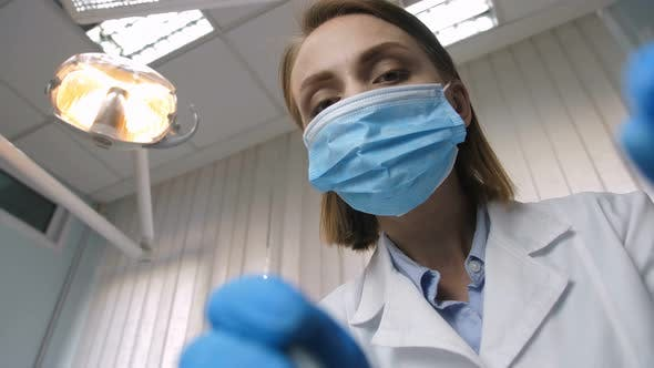 Dentist Examining Teeth, Patient Point of View