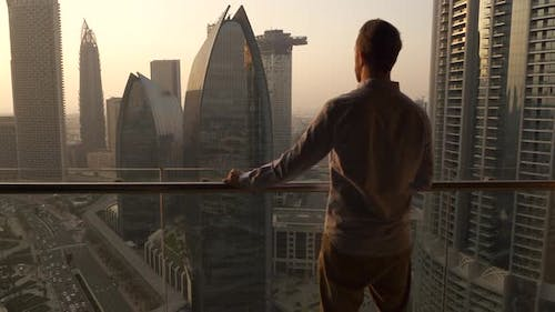 Young Business Man Succeed in Finance Career Standing on Modern Office Cityscape Balcony