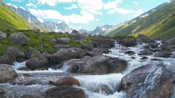 Creek at Valley in a High Altitude Mountain