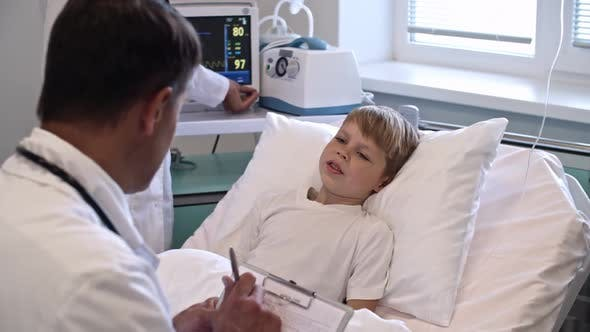 Thumbnail for Cute Boy Speaking with Doctor in Hospital Ward
