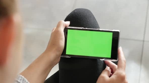 Blond woman holding  chroma key greenscreen tablet 4K 2160p 30fps UHD footage - Blonde Caucasian fem
