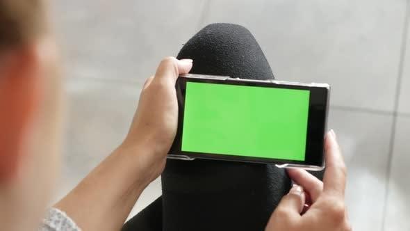 Blond woman holding  chroma key greenscreen tablet 4K 2160p 30fps UHD footage - Blonde Caucasian fem