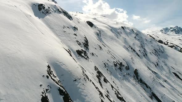 Aerial video of the Swiss Alps from Andermatt, Switzerland during winter (1)
