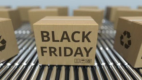 Carton Boxes with BLACK FRIDAY Text Move on Roller Conveyor