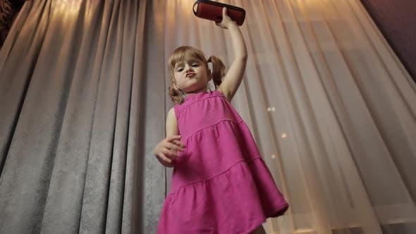 Thumbnail for Child Girl with Wireless Speaker Enjoying Listen Music. Dancing at Home
