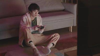 Asian Man Losing in Video Game