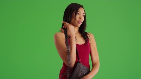 Thumbnail for Woman shopping for leather purse and trying it on to buy on green screen