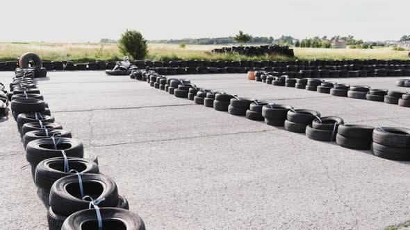 Thumbnail for Male Racer in Protective Helmet Racing on the Go-kart Track Outdoors
