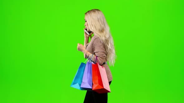 Thumbnail for Girl with Long Hair Shall Be in the Hands of Multi Colored Packages. Green Screen