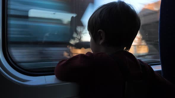 Thumbnail for Boy looking through the window in the train. Traveling with children. Boy at train.