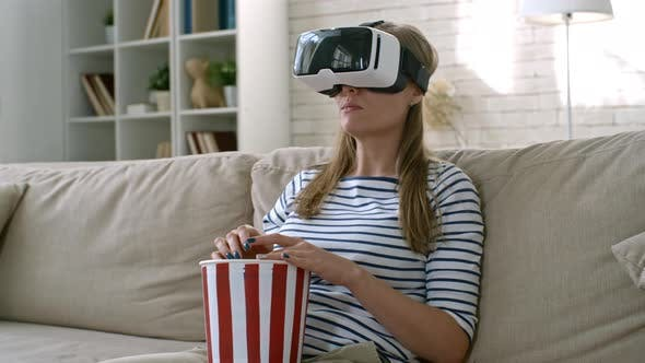 Thumbnail for Woman Enjoying Movie in VR Goggles