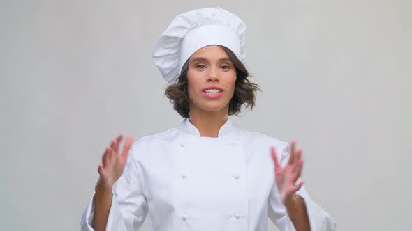 Thumbnail for Smiling Female Chef Speaking To Camera