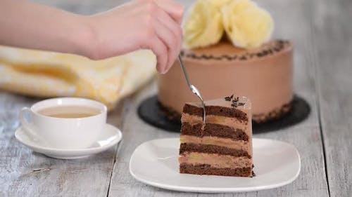 Piece of chocolate cake with banana.