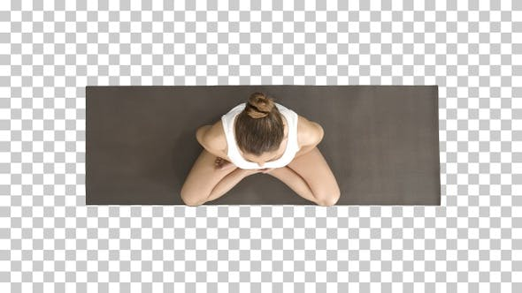 Thumbnail for Woman in white practicing yoga in lotus pose, Alpha Channel