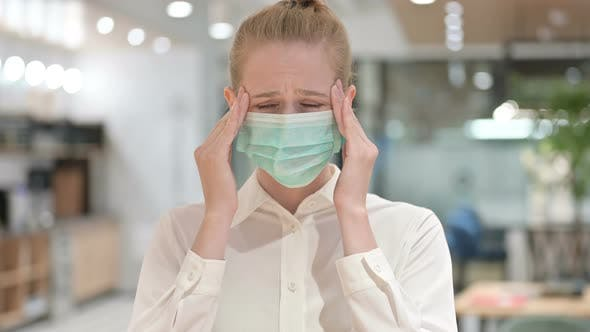 Portrait of Young Businesswoman with Face Mask Having Headache