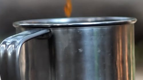 Tea Pouring Into A Mug