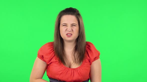 Thumbnail for Portrait of Cute Girl Is Feeling Very Bad, Her Stomach Hurting . Green Screen