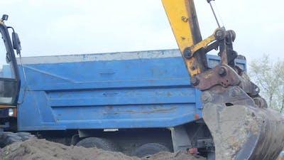 Excavator Digs The Ground
