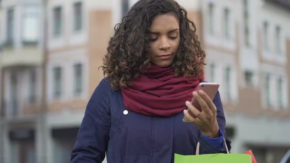Cover Image for Woman Choosing Gifts Online Browsing Sales in Web Stores on Smartphone