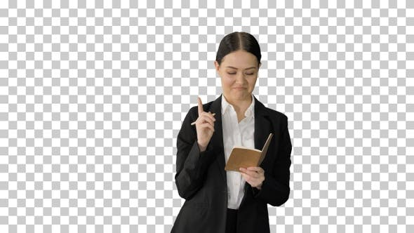 Thumbnail for Concentrated woman in a suit writing business, Alpha Channel