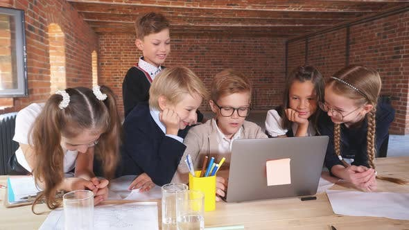 Serious Students Watching Online Lesson