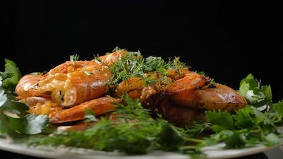 Dish with Delicious Roasted Shrimps and Dill with Parsley